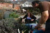 Two volunteers with wheelchair friendly beds in Adamsdown Community Garden