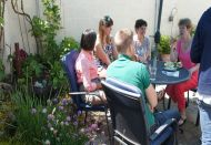 Neighbours discuss having an UpFront Garden at The Big Lunch event.