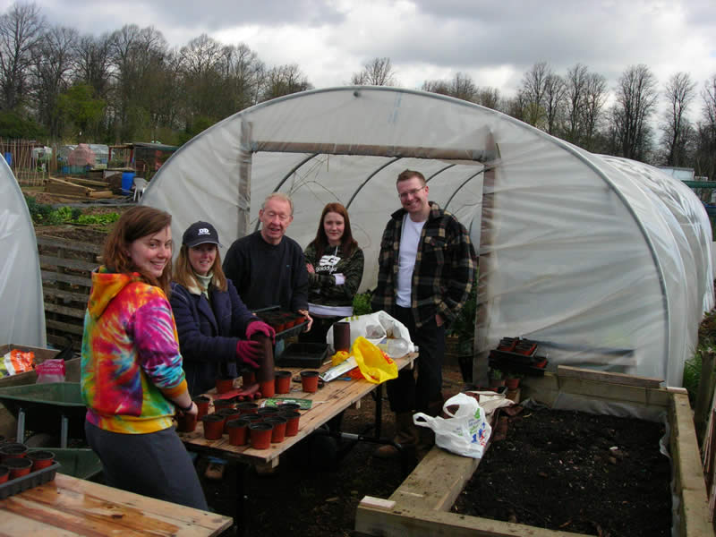 Students learn how to germinate seeds on a permaculture course and horticulture course in Cardiff, Wales